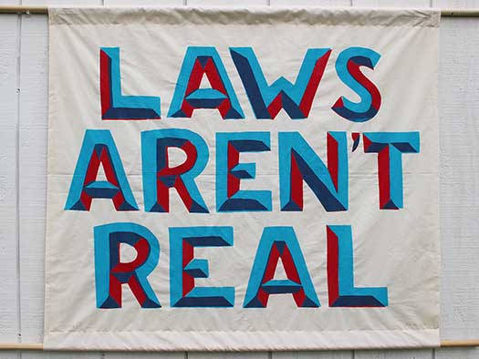 Laws Aren't Real banner