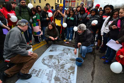 mud stencils and banners at the Milwaukee May Day – Immigrant Rights March