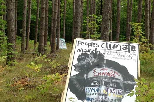 Article on the People's Climate March 30-City Wheatpasting Action: Upper Peninsula Report Back