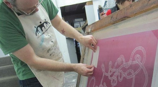 Josh MacPhee printing at AIR (Pittsburgh)
