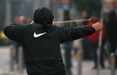 Greek-protests-slingshot.jpg